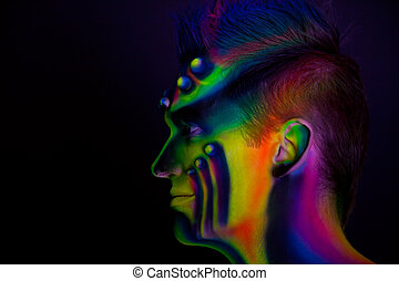 Man with fluorescent bodyart Black background Studio shot