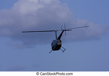 Helicopter flying against blue sky - Just after take off, a...