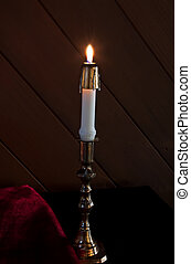 White Taper Candle Lit - This is a white taper candle, lit...