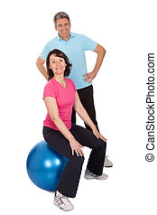 Active mature couple doing fitness Isolated on white