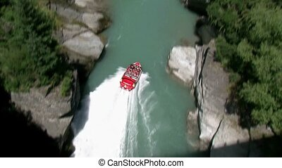 Jet boat going up shotover river - Queenstown, New Zealand...