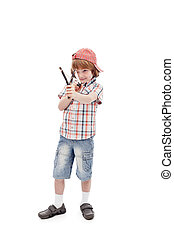 Young boy with sling aiming