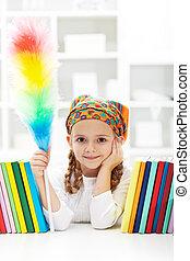 Little girl dusting in her room