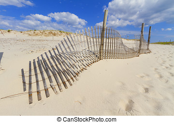 Sand dunes - Sand dunes on Atlantic coast with a fence