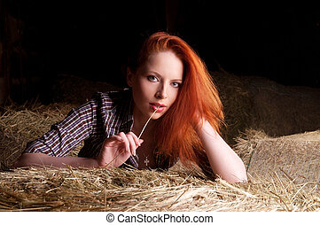 girl with red hair - Beautiful young girl with red hair is...