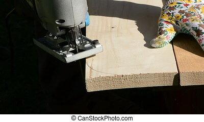 carpenter cut wooden plank
