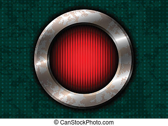Rusty metal circle with red lamp on the green surface