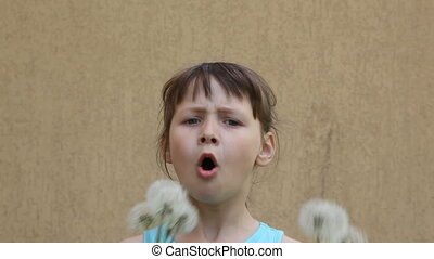 dandelion - girl blowing a dandelion