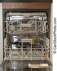 Almost empty dishwasher - Interior of almost empty...
