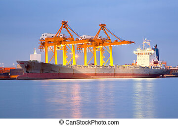 Shipping at dusk - Big Container Cargo freight ship with...