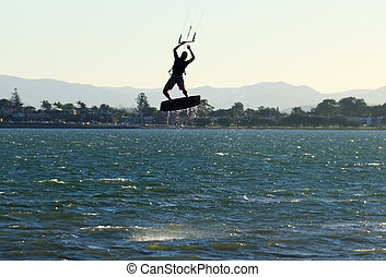 Airborne Kite Surfer - Kite surfer airborne above the water...