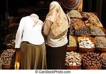 Aswan Cityscape - Muslim Women in Aswan market, Egypt.