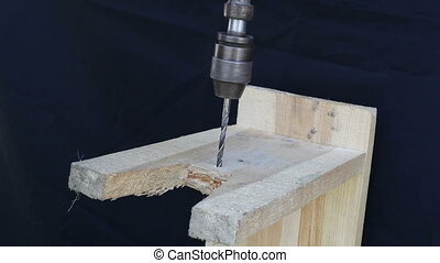 hand drill and board