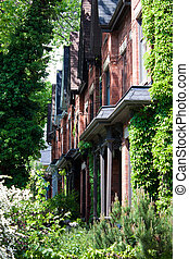 Cabbagetown Victorian Rowhouses - Side angled view of row of...