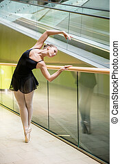 Ballet dancer at escalator - Ballet dancer ballerina dancing...