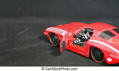 red car - small model car. The red car.