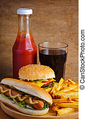 Fast food with burger, hot dog, french fries, tomato ketchup...