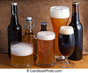 Beer - Glass and bottles of beer on a wooden background