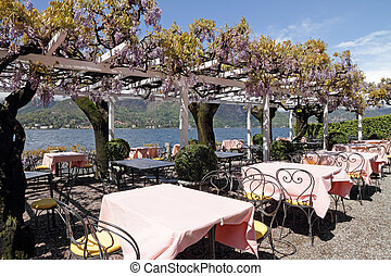 Outdoor restaurant on lake Como - with beautiful pergola...
