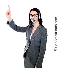 Female executive pointing up at copyspace