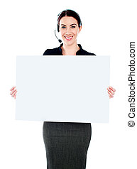 Call centre executive standing with a blank billboard