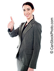 Successful business lady showing thumbs-up
