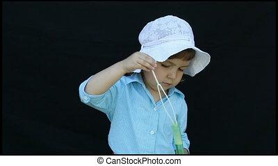 bubbles - child blowing soap bubbles
