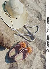Beach items lying on sand