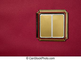 Golden socket on red background