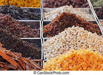 Dry fruits and spices displayed for sale in a bazaar - Dry...