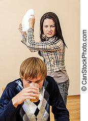 Domestic violence: Wife trying to beat her husband with a...