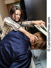 Office revenge: Woman tries to shove the man in the copy machine