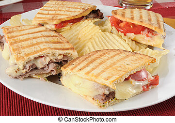 Grilled roast beef panini with potato chips - A roast beef...
