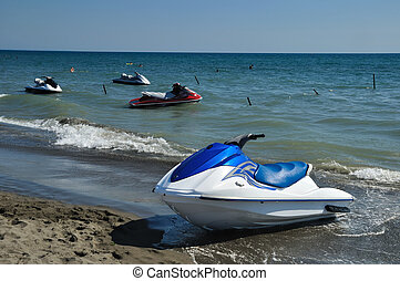 Jet ski on the sand at the beach