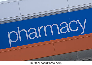 Pharmacy Signage - A sign on the side of a building annouces...