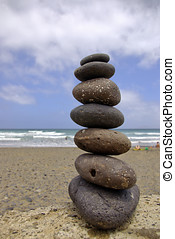 Balancing beach pebbles - Beach holiday and balancing...