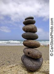 Balancing beach pebbles - Beach holiday and balancing...
