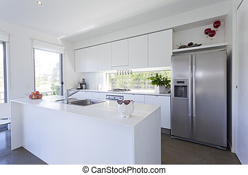 Modern kitchen with stainless steel appliances in Australian...