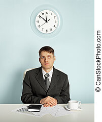 Businessman waiting in an office at the workplace