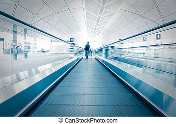 passenger rushing through an escalator - passenger (Man)...