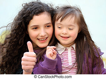 Portrait of beautiful young girls on the playground