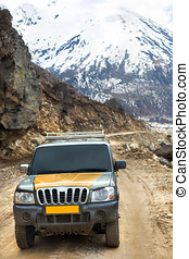 Adventure car on the way to Chopta Valley , Sikkim with snow...