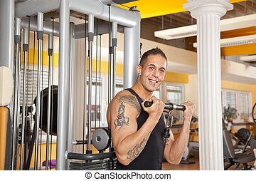 smiling man exercising in gym