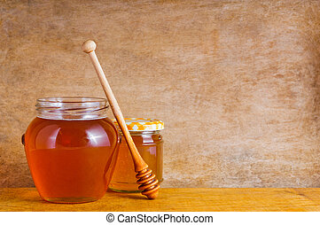 Natural honey on vintage wooden background