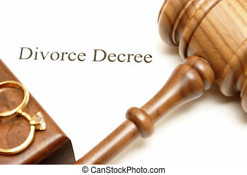 Divorce Papers - A gavel and wedding rings on top of divorce...