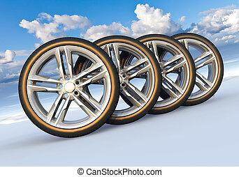 Set of car wheels in snowy landscape