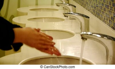 Wash hands at Luxurious faucets toilets.