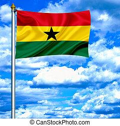 Antigua and Barbuda waving flag against blue sky