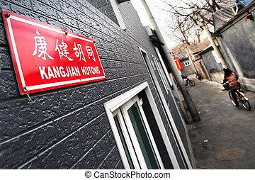 Beijing China - A Chinese woman on a bike in Kangjian...