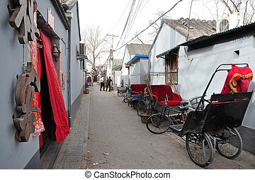 Beijing China - bicycle rickshaw in a Hutong.